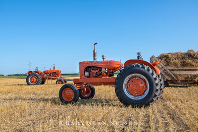 1955 Allis-Chalmers Model WD-45 with 1951 Allis-Chalmers WD in background.