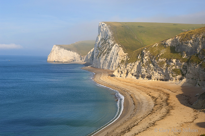 GB-11-31-ENG Fog and early morning light over  Bat's Head and Swyre  Head, Dorset, England, part of the Jurassic Coast World...