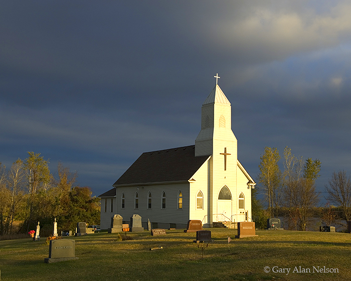 storm clouds over country church