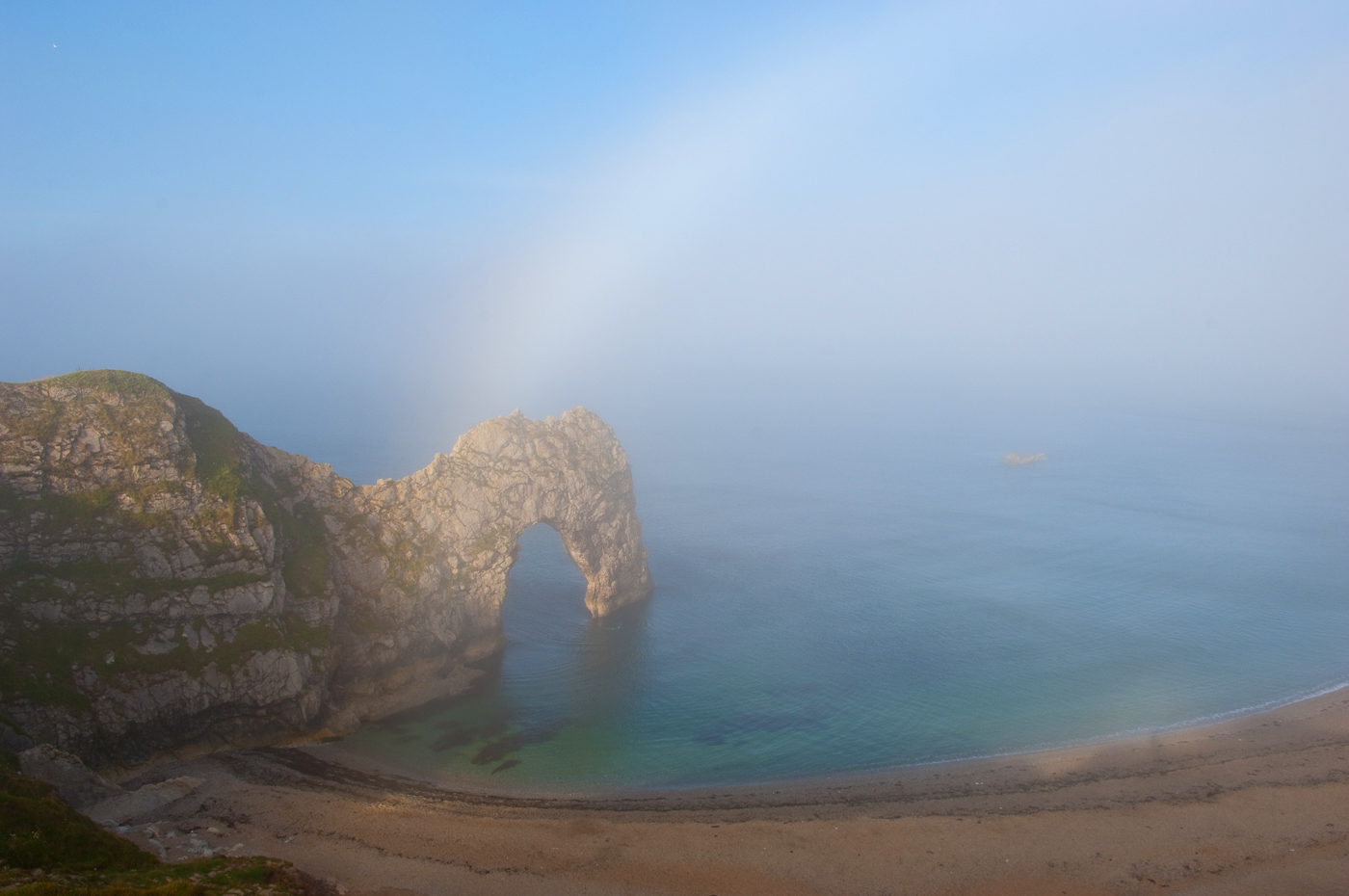 Fog over Durdle Door and the Jurassic Coast World Heritage Site.