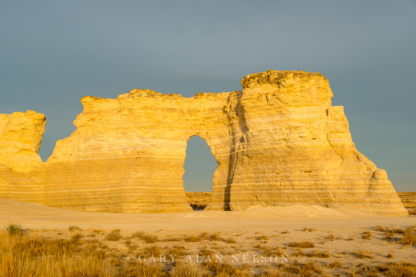 Monument rocks and keyhole arch under clouds, Monument Rocks National Monument, Kansas