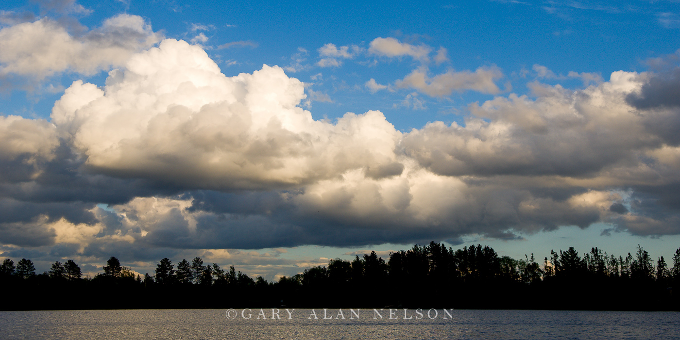 moon lake, minnesota, cumulous clouds, silhouette, photo