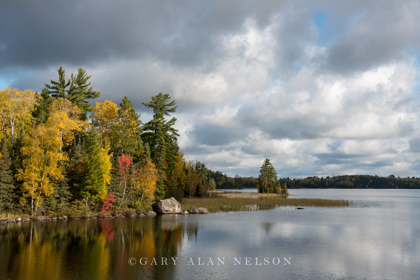 Autumn colors and clouds over the Kawishiwi River, Superior National Forest, Minnesota.