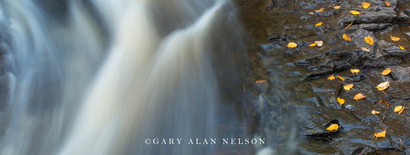 Water falling in autumn on the Cascade River, Cascade River State Park, Minnesota