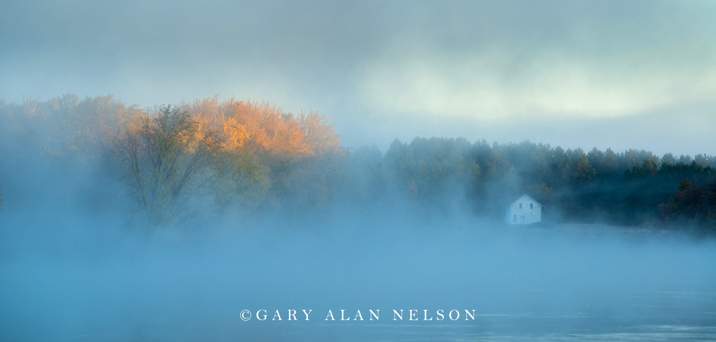 Fog over the Mississippi River and the historic Beaulieu House in the Old Crow WIng Townsite, Crow Wing State Park, Minnesota...