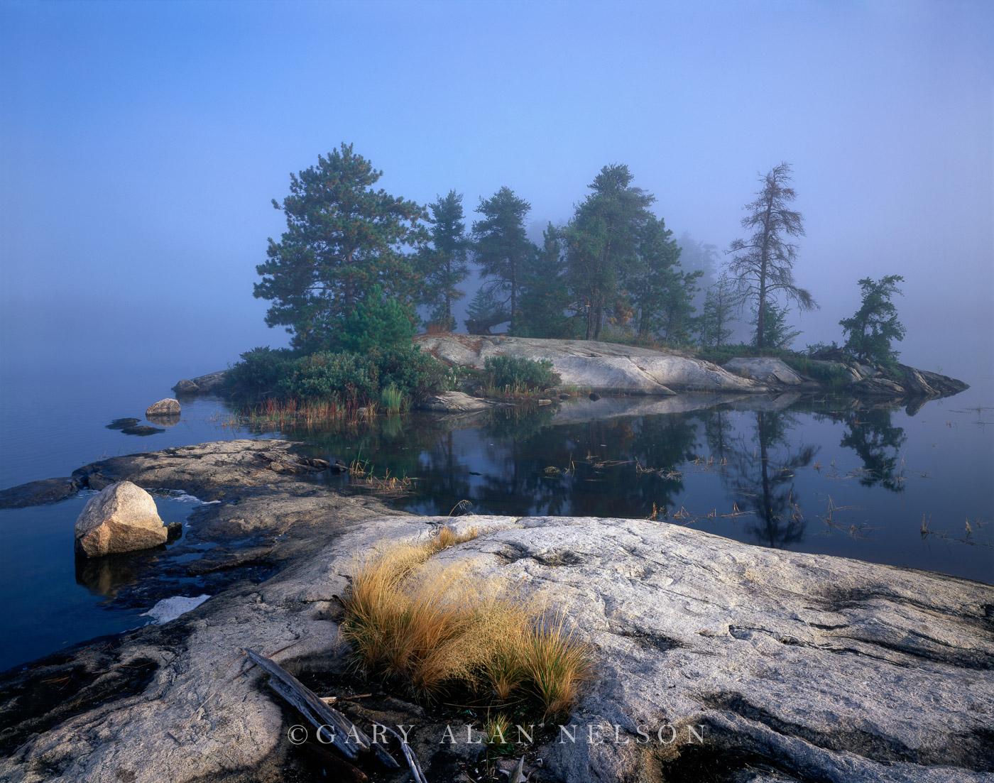 MN-97-126-NP Smooth granite islands on foggy morning, Sand Point Lake, Voyageurs National Park, Minnesota