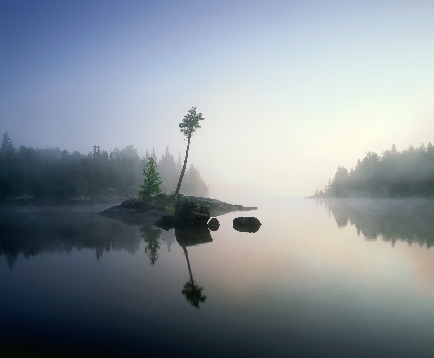 Calm water and fog on Lake Three, Boundary Waters Canoe Area Wilderness, Northern Minnesota