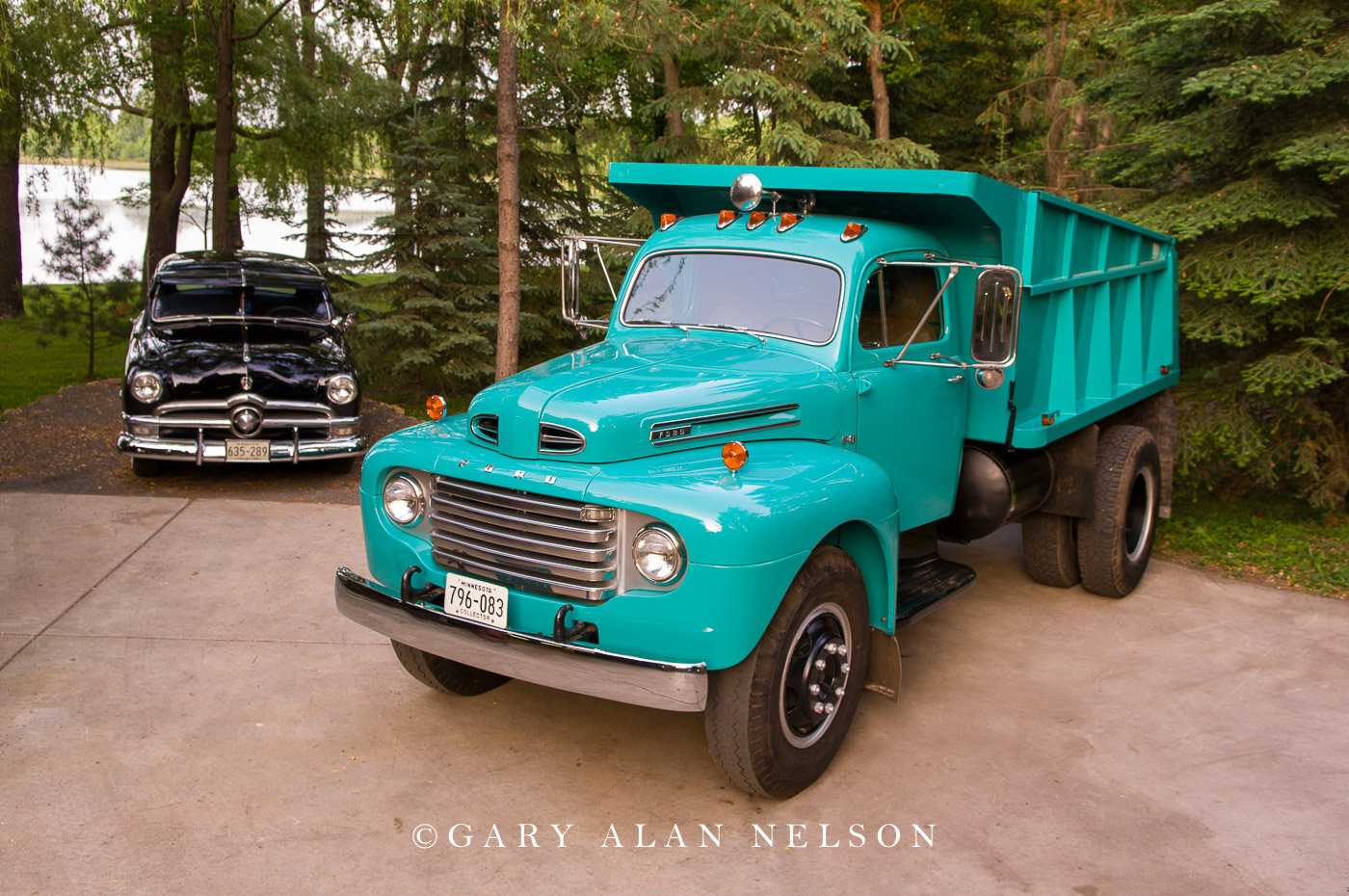 VT-07-70-FO 1950 Ford F-8 Dump Truck and a 1950 Ford Deluxe automobile