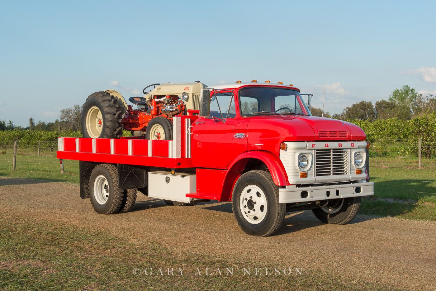 1963 Ford N600 Flatbed carrying a 1951 Ford 8N Tractor