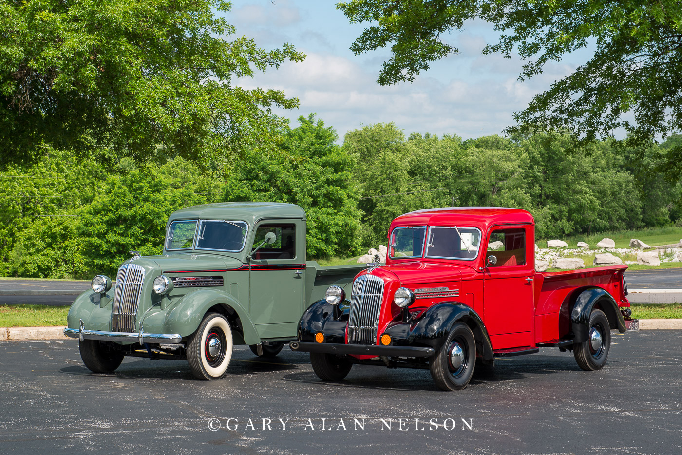 A pair of 1937 REO Speed Delivery Wagons