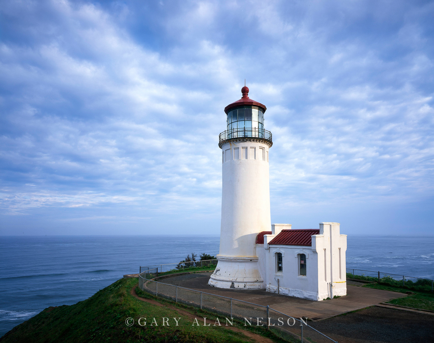 WA-03-4-LH Scattered clouds over the North Head Lighthouse, EST. 1998, Fort Canby State Park, Washington